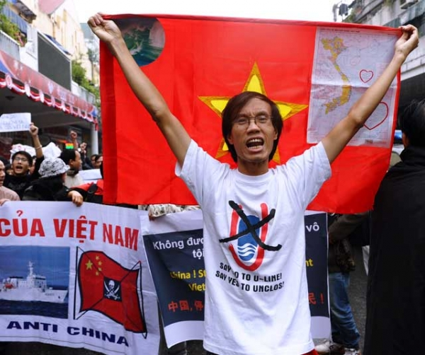 Amid heightened territorial tensions over the South China Sea, protestors shout anti-China slogans and hold banners as they march towards the Chinese embassy in downtown Hanoi on Dec. 9, 2012. (Hoang Dinh Nam/AFP/Getty Images)