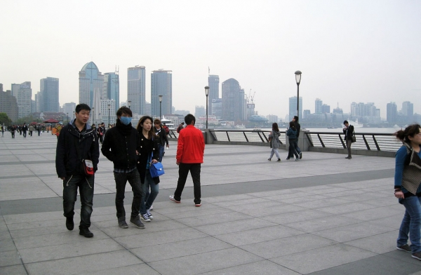 Despite public concern about the emergence of H7N9 bird flu in Shanghai, only a handful of pedestrians walking along the waterfront Bund on April 8, 2013 chose to don face masks. (Maura Elizabeth Cunningham)