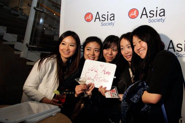 Another group of guests poses for a photo at the photo booth. (Tahiat Mahboob/Asia Society)