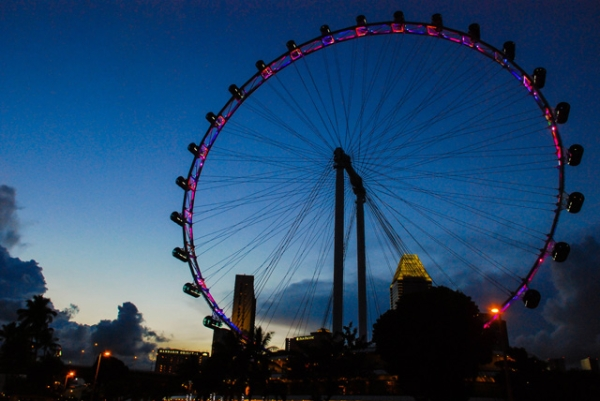 A ferris wheel is lit up at dusk in Singapore on May 5, 2013. (Eduardo S. Seastres)
