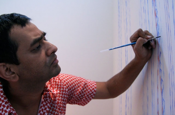 Imran Qureshi working on his site-specific painting at Asia Society Museum in 2009. (Asia Society/Bill Swersey)