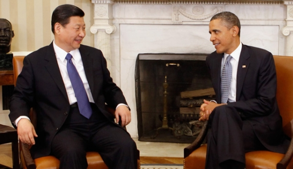 U.S. President Barack Obama (R) and then-Chinese-Vice-President Xi Jinping pose for photographs before meeting in the Oval Office at the White House February 14, 2012 in Washington, DC. (Chip Somodevilla/Getty Images)
