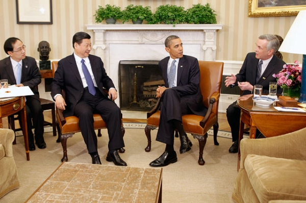 U.S. President Barack Obama (2nd R) and Chinese then-Vice President Xi Jinping (2nd L) communicate through translators while meeting in the Oval Office at the White House on Feb. 14, 2012 in Washington, DC. (Chip Somodevilla/Getty Images)
