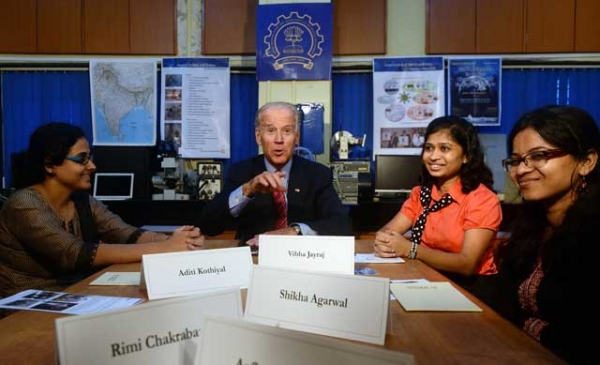 U.S. Vice President Joe Biden (C) interacts with students during a visit to the Indian Institute of Technology (IIT) in Mumbai on July 25, 2013. (Indranil Mukherjee/AFP/Getty Images)