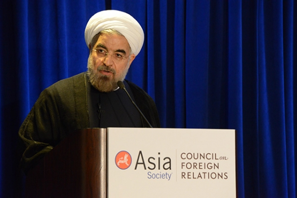 Iranian President Hassan Rouhani delivers remarks at the Hilton Hotel in New York City on September 26, 2013. (Kenji Takigami/Asia Society)