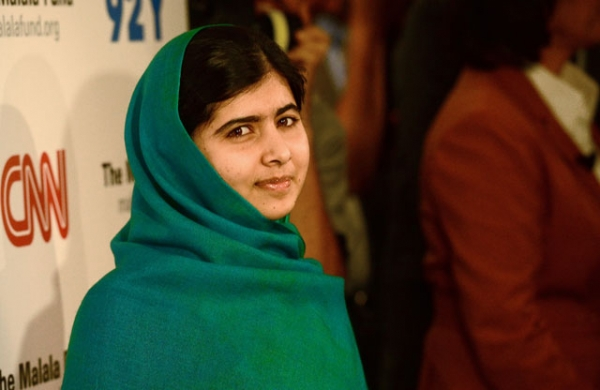 Pakistani student Malala Yousafzai poses for photographers before a panel discussion in New York City on Oct. 10, 2013, the same day she was awarded the European Parliament's prestigious Sakharov human rights prize. (Emmanuel Dunand/AFP/Getty Images)