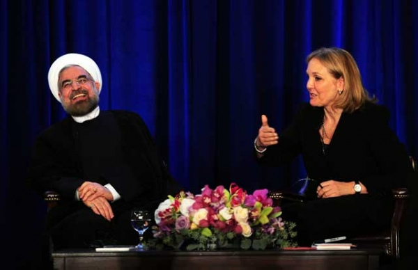 Iranian President Hassan Rouhani smiles while answering questions from Asia Society President Josette Sheeran at an Asia Society event on the sidelines of the 68th UN General Assembly in New York on Sept. 26, 2013. (Emmanuel Dunand/Getty Images)