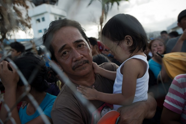 Typhoon victims wait to have a chance to board a flight to evacuate the area at Tacloban airport on November 14, 2013. (Nicolas Asfouri/AFP/Getty Images)