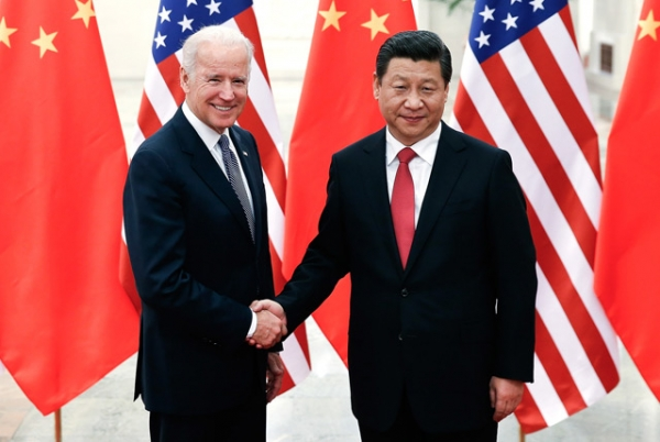 Chinese President Xi Jinping (R) shakes hands with US Vice President Joe Biden (L) inside the Great Hall of the People in Beijing on December 4, 2013. (Lintao Zhang/AFP/Getty Images)