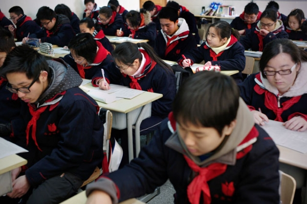 "Students in class at the Jing'an Education College Affiliated School in Shanghai, China, whose school system was named ""best in the world"" by OECD earlier this week. (Philippe Lopez/AFP/Getty Images)"