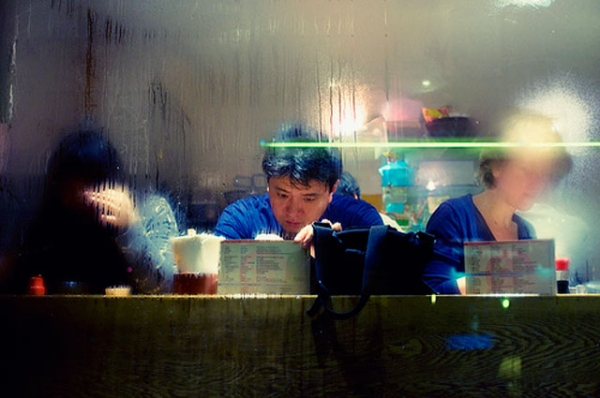 Customers studying a menu at a Japanese restaurant. (christophe HUE/flickr)