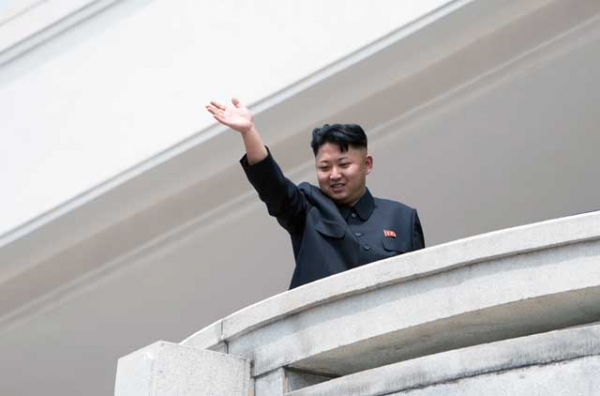"North Korean leader Kim Jong Un, shown here reviewing a military parade in Pyongyang on July 27, could be waving goodbye to hopes from the international community that he would ""behave better"" in 2013.  (Ed Jones/AFP/Getty Images)"