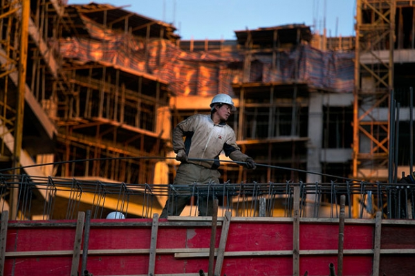 A Chinese construction worker sets rebar on an apartment building under construction as a development and a real estate boom takes hold in Ulaanbaatar, Mongolia, in October 2012. (Paula Bronstein/Getty Images)