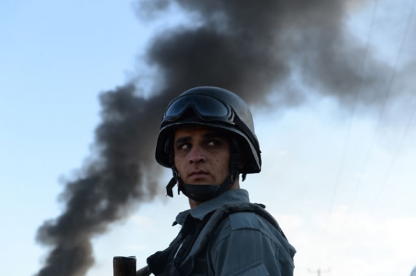 An Afghan policeman stands guard at the site of a suicide attack in Kabul on July 2, 2013. (Shah Marai/AFP/Getty Images)