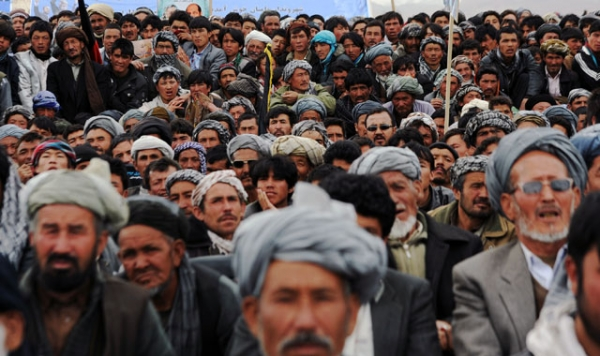 Afghan men crowd a field at a political rally during a campaign stop by presidential candidate Zalmai Rassoul in Bamiyan on April 1, 2014. (Hashmatullah/AFP/Getty Images)