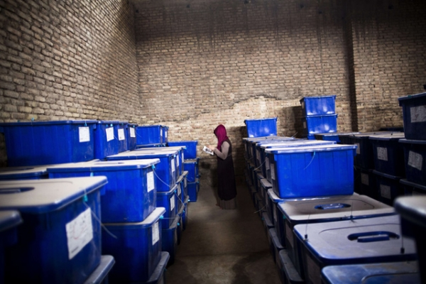 Afghan election employee, Forouzan Barez checks the plastic boxes containing election material at a warehouse prior to transportation to the polling centers, in the northwestern city of Herat on April 3, 2014. (Behrouz Mehri/AFP/Getty Images)