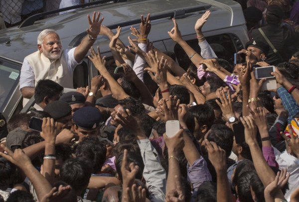 BJP leader Narendra Modi waves to supporters after voting at a polling station on April 30, 2014 in Ahmedabad, India. (Kevin Frayer/Getty Images)