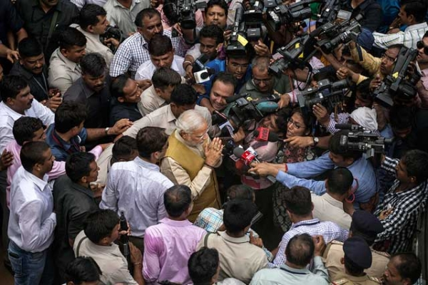 BJP leader Narendra Modi surrounded by supporters, security, and media after visiting his mother on May 16, 2014 in Ahmedabad, India. (Kevin Frayer/Getty Images)