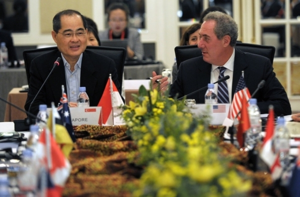 Singapore Minister of Trade and Industry Lim Hng Kiang (L) speaks as US trade representative Michael Froman (R) looks on during the Trans-Pacific Partnership (TPP) Ministerial Meeting in Singapore on May 19, 2014. Trade Ministers and officials from the 12 TPP countries -- Australia, Brunei, Canada, Chile, Japan, Malaysia, Mexico, New Zealand, Peru, the US, Vietnam and Singapore -- convened for the meeting. (Roslan Rahman/AFP/Getty Images)
