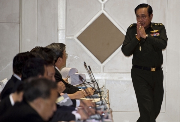 Thai army chief General Prayut Chan-O-Cha gives a traditional greeting to delegates during a meeting at the Army Club in Bangkok on May 20, 2014. Thailand's army declared martial law after months of deadly anti-government protests, deploying armed troops in central Bangkok and censoring the media but insisting the move was 'not a coup'. (Pornchai Kittiwongsakul/AFP/Getty Images)