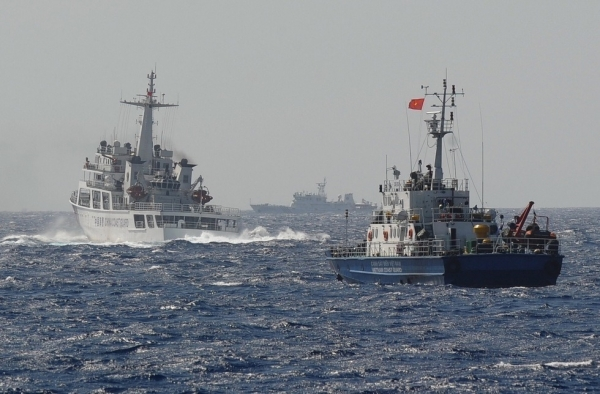 This picture taken on May 14, 2014 shows a Chinese coast guard vessel (L) followed by a Vietnamese coast guard ship (R) near the area of China's oil drilling rig in disputed waters in the South China Sea. (Hoang Dinh Nam/AFP/Getty Images)