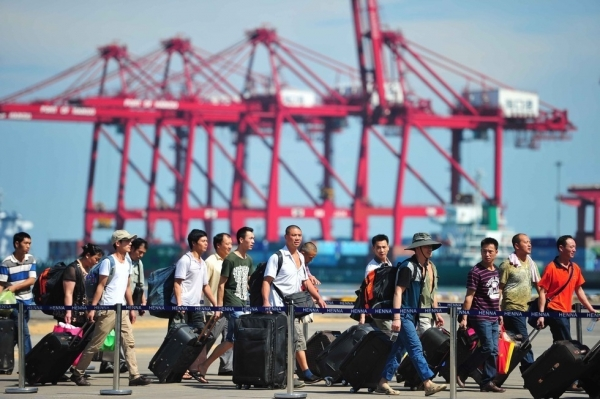 Chinese nationals disembark from the passenger vessel Wuzhishan after the ship arrived at the Xiuying Port on May 20, 2014 in Haikou, China. The first group of violence-stricken Chinese workers, 989 in total, arrived at Xiuying Port from Vietnam to escape rioters protesting against a Chinese oil rig that was erected in an area of the South China Sea that they believe to be Vietnamese territory. (ChinaFotoPress/Getty Images)