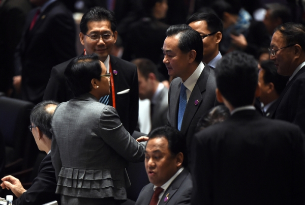 China's Foreign Minister Wang Yi (center R) shakes hands with Indonesia's Foreign Minister Retno Marsudi (front L) during the Asia-Pacific Economic Cooperation (APEC) Summit at the China National Convention Centre (CNCC) on November 7, 2014 in Beijing, China. (Greg Baker/Getty Images)