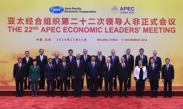 Leaders from Asia-Pacific Economic Cooperation (APEC) economies pose for a group photo at Yanqi Lake, north of Beijing on November 11, 2014. (Greg Baker/Getty Images)