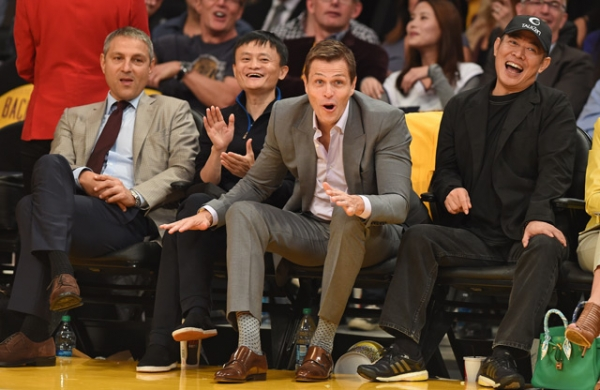 L to R: Talent agent Ari Emmanuel, Alibaba founder Jack Ma, talent agent Patrick Whitesell, and actor Jet Li attend the Los Angeles Lakers versus Houston Rockets NBA game at the Staples Center in Los Angeles on Oct. 28, 2014. (Robyn Beck/AFP/Getty Images)