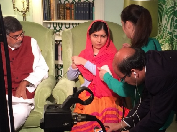 Yusra Sami Askari, in green, prepares Malala Yousafzai for an on-camera interview in Oslo. (Yusra Sami Askari)