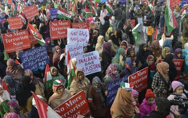 Pakistan Awami Tehreek (PAT) activists rally for the victims of the Peshawar school massacre, in Lahore on December 21, 2014. Al-Qaeda's regional branch on December 21 said its hearts were 'bursting with pain' over the Taliban's massacre at a Pakistan school and urged the militants to target only security forces. (Arif Ali/AFP/Getty Images)