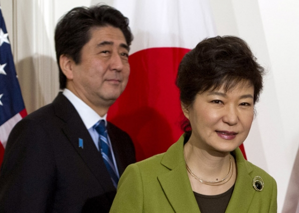 Japanese Prime Minister Shinzo Abe (L) and South Korean President Park Geun-hye arrive for a trilateral meeting with the U.S. president in The Hague on March 25, 2014. (Saul Loeb/AFP/Getty Images)