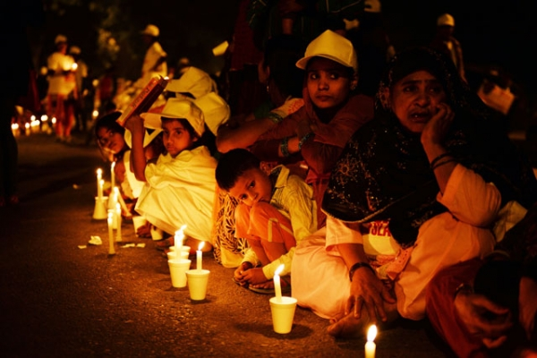Children are pictured with candles during a protest against child slavery attended by Indian Nobel laureate Kailash Satyarthi in New Delhi on Nov. 22, 2014. (Chandan Khanna/AFP/Getty Images)