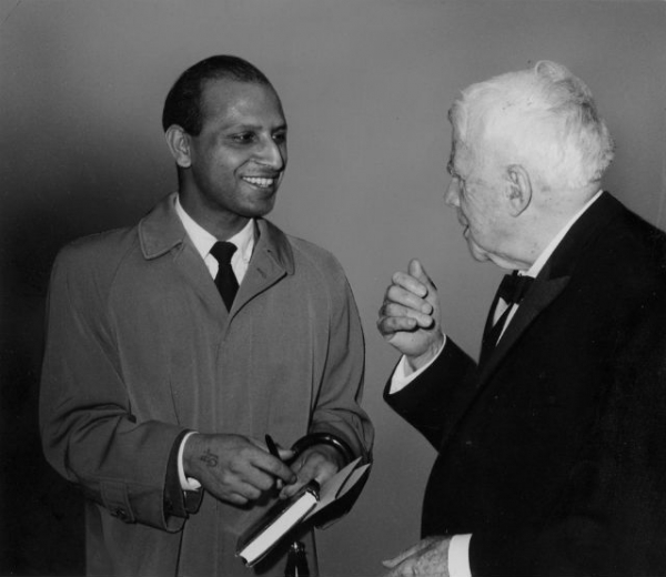 American poet Robert Frost, right, speaks with a guest at an homage to the Indian writer Sir Rabindranath Tagore (1861-1941) in an Asia Society-sponsored program held in New York's Town Hall in 1961. (Asia Society)