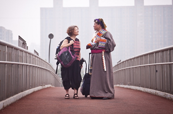 Reporter Jocelyn Ford and Zanta, the subject of her film, stand on a Beijing overpass. (Jocelyn Ford)