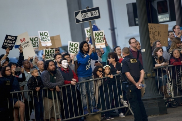 People protesting the Trans-Pacific Partnership (TPP) gather as US President Barack Obama attends a fund raiser for the Democratic National Committee at the Sentinel Hotel May 7, 2015 in Portland, Oregon. (Brendan Smialowski/AFP/Getty Images)