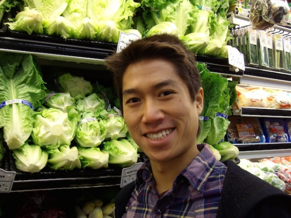 Author Tao Lin poses in front of the produce section at New York City grocery store. (Tao Lin)