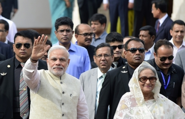 Indian Prime Minister Narendra Modi (L) gestures as Bangladeshi Prime Minister Sheikh Hasina looks on as he arrives at the Prime Minister's Office in Dhaka on June 6, 2015. (Munir Uz Zaman/Getty Images)
