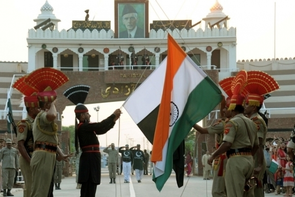 Pakistani Rangers, in black, and Indian Border Security Force (BSF) personnel perform the daily retreat ceremony on the India-Pakistan Border at Wagah on September 17, 2014. (Narinder Nanu/Getty Images)