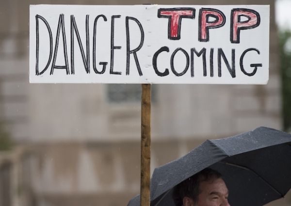 Demonstrators protest against the legislation to give US President Barack Obama fast-track authority to advance trade deals, including the Trans-Pacific Partnership (TPP), during a protest march on Capitol Hill in Washington, DC, May 21, 2015.  (Saul Loeb/AFP/Getty Images)