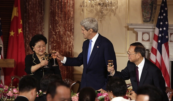 US Secretary of State John F. Kerry (C) makes a toast with Liu Yandong (L), Chinese Vice Premier, and Chinese State Counselor Yang Jiechi (R) during the seventh US-China Strategic and Economic Dialogue (S&ED) at the US State Department in Washington DC, June 23, 2015. (Chris Kleponis/AFP/Getty Images)