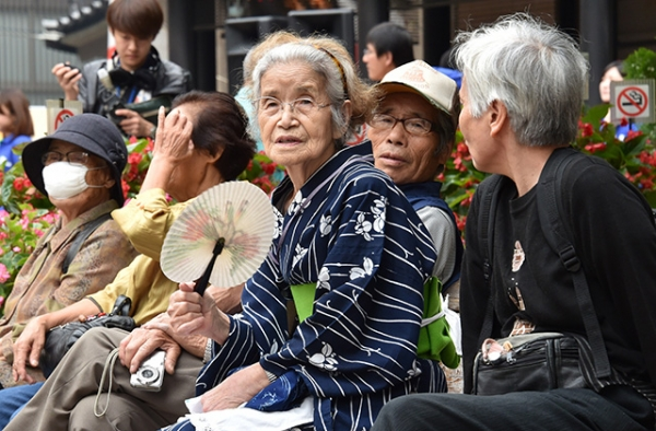 Elderly Tokyo residents rest in a temple on September 15, 2014 as the country marks Respect for the Aged Day. (Yoshikazu Tsuno/AFP/Getty Images)
