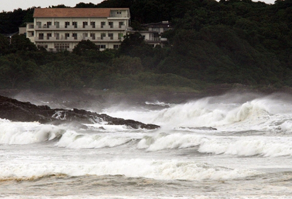 High waves crash into the coast at Hyuga in Miyazaki prefecture, Japan's southern island of Kyushu on July 16, 2015. (Jiji Press/AFP/Getty Images)