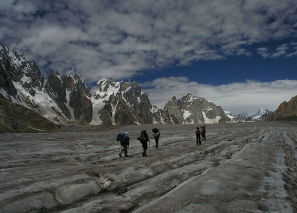 Hikers walk up the Biafo glacier towards Snow Lake in northern Pakistan. (Ben Tubby/Flickr)