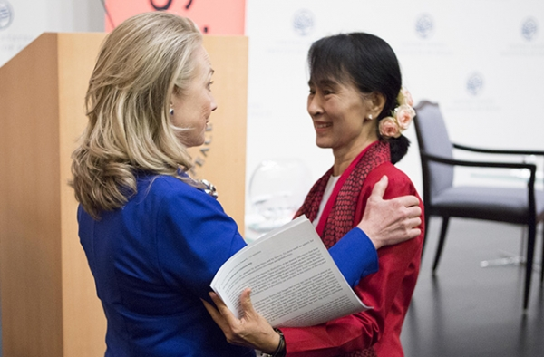 Then Secretary of State Hillary Clinton (L) greets Aung San Suu Kyi before the Myanmar parliamentarian spoke at an event co-hosted by Asia Society and the U.S. Institute of Peace in Washington, D.C. on September 18, 2012. (Asia Society/Joshua Roberts)