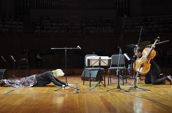 Meryl Streep and Yo-Yo Ma bow to eachother after a performance in Beijing on November 18, 2011. (Asia Society)