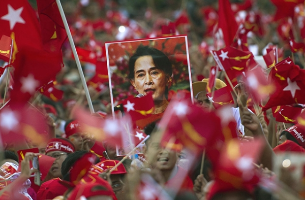 Supporters of Aung San Suu Kyi hold posters bearing her image as they listen to her speak during a campaign rally for the National League for Democracy in Yangon on November 1, 2015. (Ye Aung Thu/AFP/Getty Images)