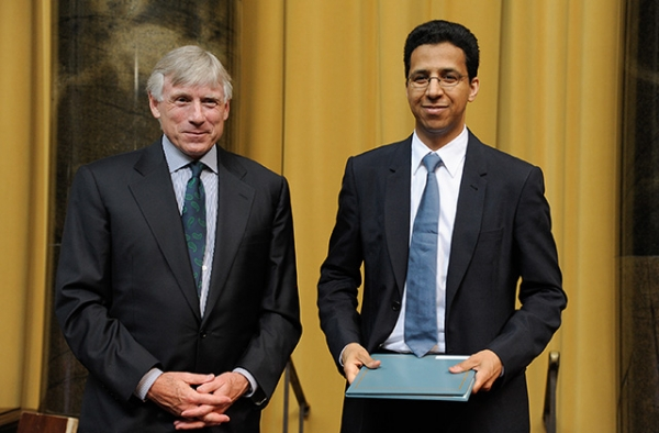 David Barboza (R) receives an award from Columbia University President Lee C. Bollinger at the annual Pulitzer Prizes in Journalism, Letters, Drama, and Music Winners Luncheon at Columbia University on May 30, 2013 in New York City. (Dave Kotinsky/Getty Images)
