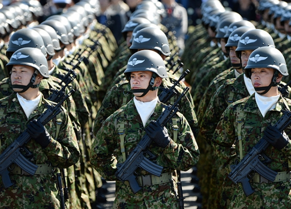 Critics fear that the legislative changes made to Article 9 last November will lead to the swift remilitarization of Japan. (Toru Yamanaka/AFP/Getty Images)