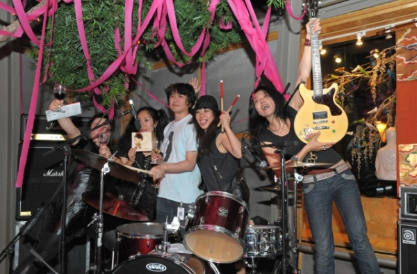 Artist Yoshitomo Nara (center) poses with the punk band High Teen Boogie at Asia Society in New York on September 13, 2010. (Elsa Ruiz/Asia Society)